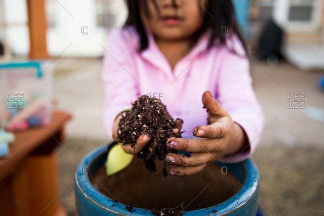 Girl digging through dirt