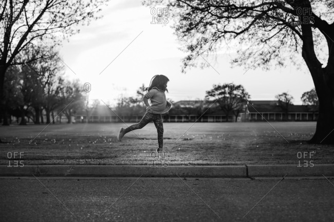 Girl jumping alone in field