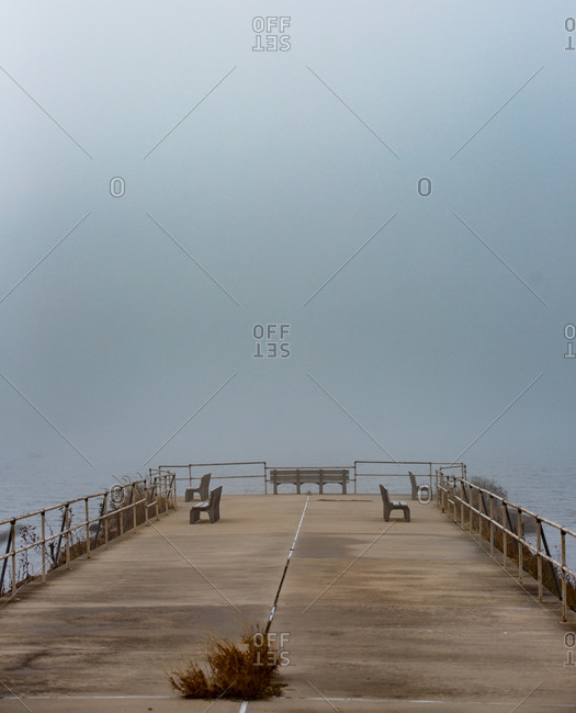Empty foggy pier