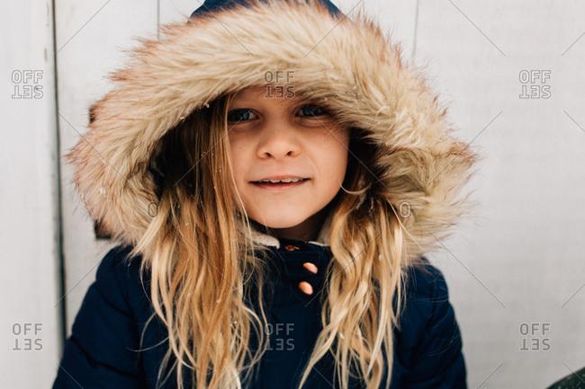 Portrait of little girl with furry hood