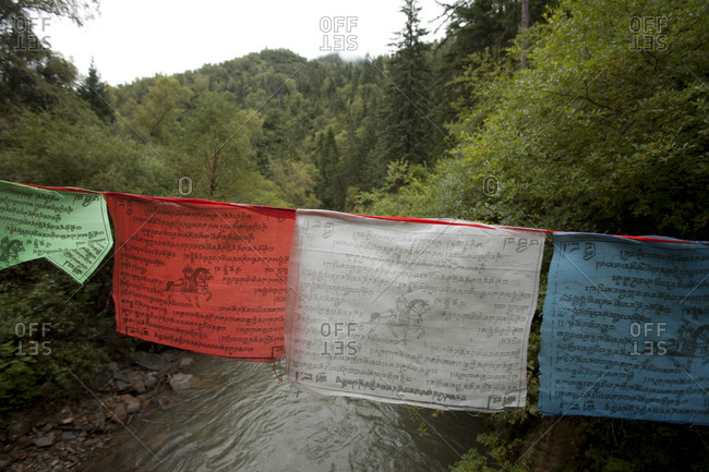 Prayer Flags over River in Jiuzhai Valley