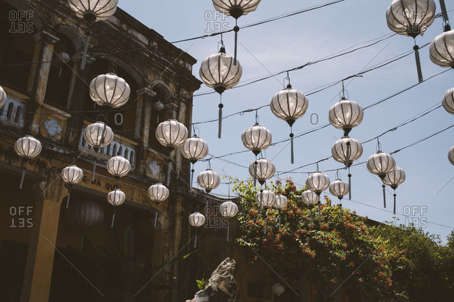 Vietnam, Hoi An - June 28, 2017: Low angle view of lanterns hanging on cables against sky