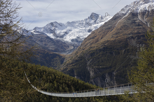 Rope bridge against mountains