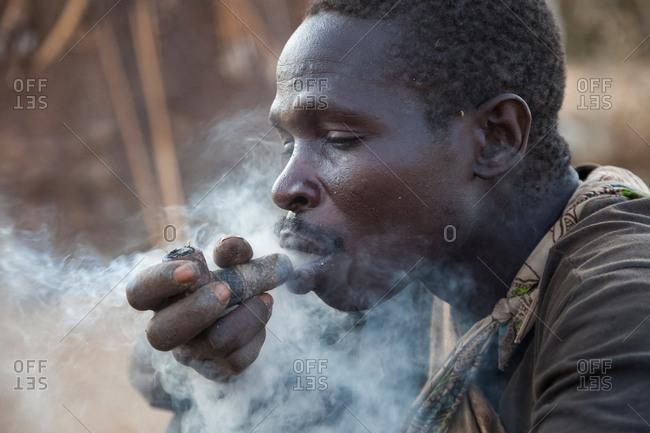 Hadzabe Tribe ,adult man smoking
