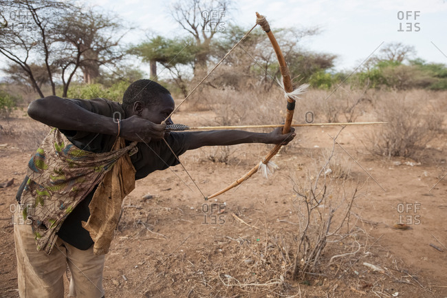 Tanzania, Africa - October 15, 2014: Hadzabe Tribe, hunting hunter with bow and arrows