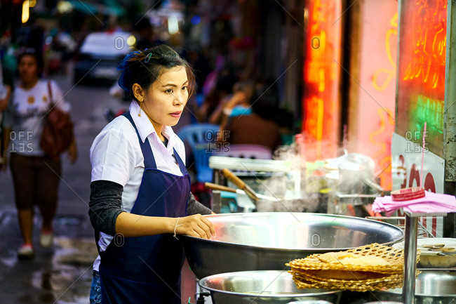 Bangkok, Thailand - September 29, 2017: Restaurant worker in Chinatown