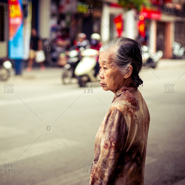 Hanoi, Vietnam  - April 26, 2015: Elderly woman on street