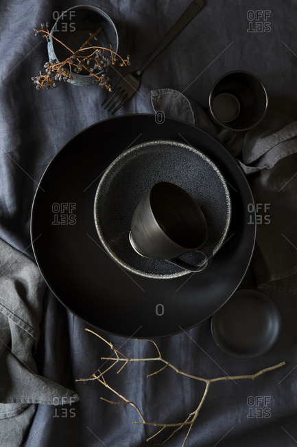 Black ceramics on grey linens