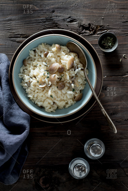 Mushroom risotto with salt and pepper shakers
