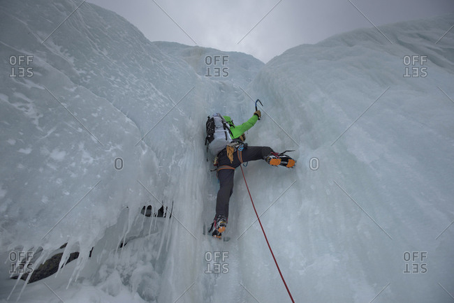 Rear view of man climbing icy wall in Huntington Ravine, New Hampshire, USA