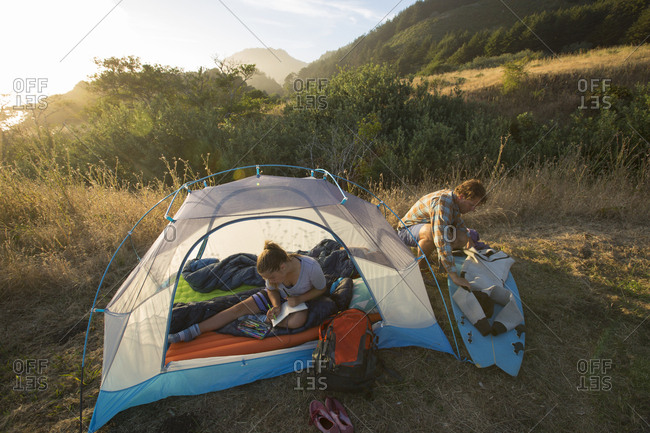 Father and daughter camping in tent at Lost Coast, Sinkyone Wilderness State Park, Shelter Cove, California, USA