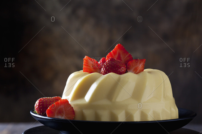 Custard with strawberries on plate