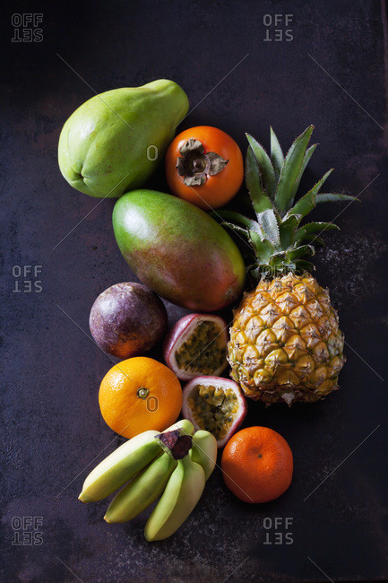 Tropical fruits on dark ground