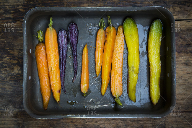 Oven winter vegetables- carrot- beetroot- and parsnip in roasting tray