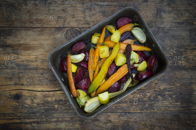 Oven winter vegetables- carrot- beetroot- potato and parsnip in roasting tray