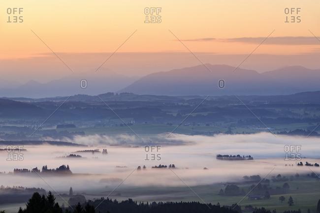 Germany- Bavaria- Upper Bavaria- Allgaeu- Pfaffenwinkel- View from Auerberg near Bernbeuren- morning fog over Lech Valley during sunrise