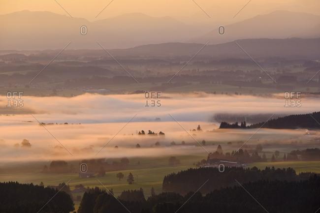 Germany- Bavaria- Upper Bavaria- Allgaeu- Pfaffenwinkel- View from Auerberg near Bernbeuren- Lech Valley- morning fog during sunrise