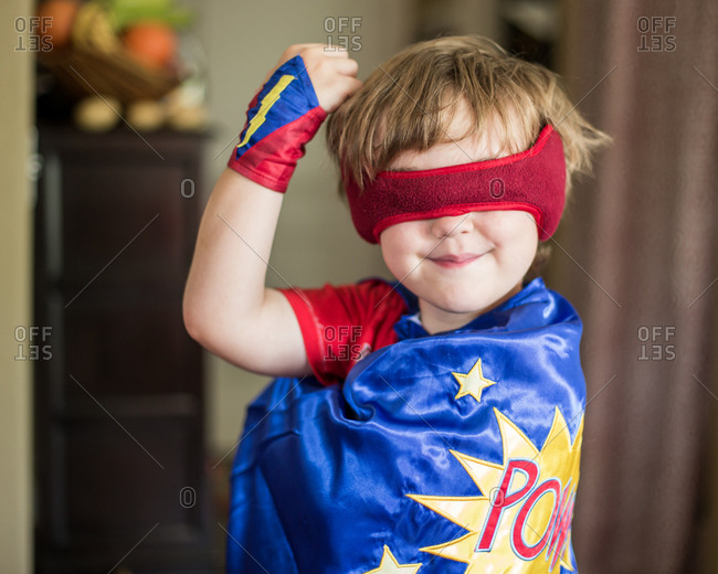 Little boy dressed up in super hero costume