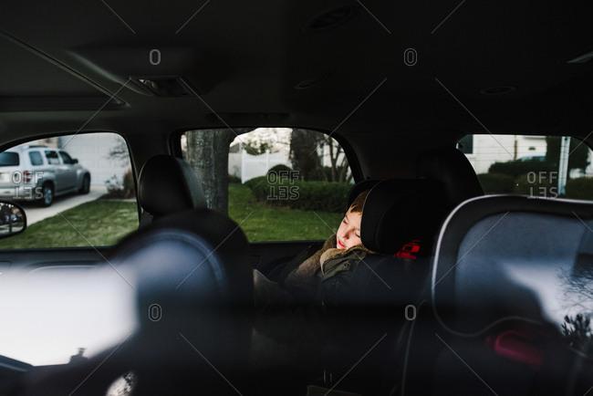 Boy sleeping in a car
