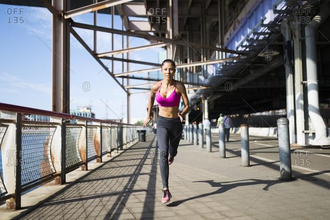 Woman training in the morning in Manhattan near Brooklyn Bridge