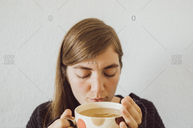 Woman with hot cup of tea