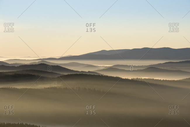 Germany- Bavaria- Lower Bavaria- Bavarian Forest National Park- near Finsterau- View from Siebensteinkopf- morning fog and National Park Sumava in Czechia