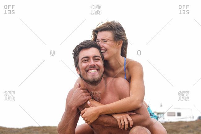 Portrait of laughing couple on the beach