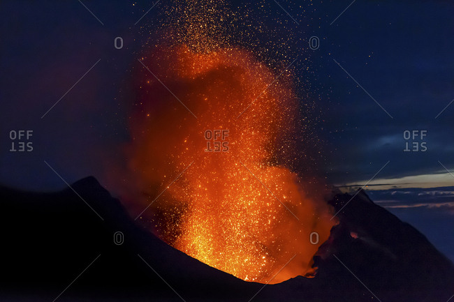 Italy- Aeolian Islands- Stromboli- volcanic eruption before night sky background- lava bombs