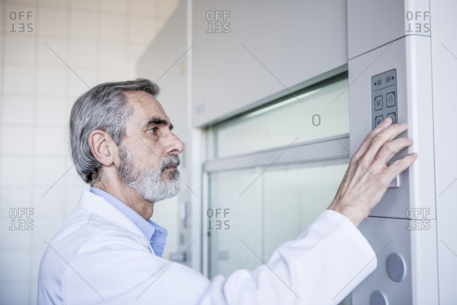 Scientist in lab handling security system