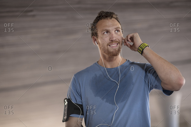 Man exercising and listening to music wearing earphones