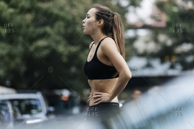 Tired Woman Catching Her Breath After Jogging