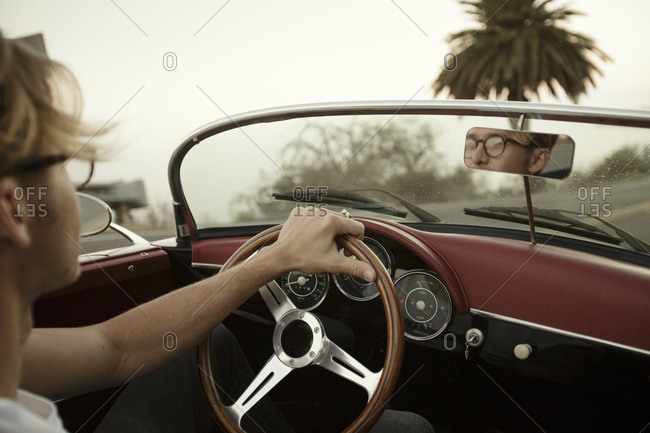 Man Driving Convertible During Road trip