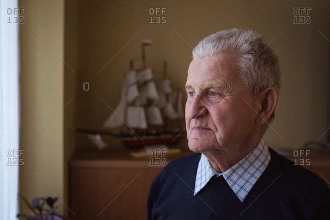 Senior man standing at nursing home