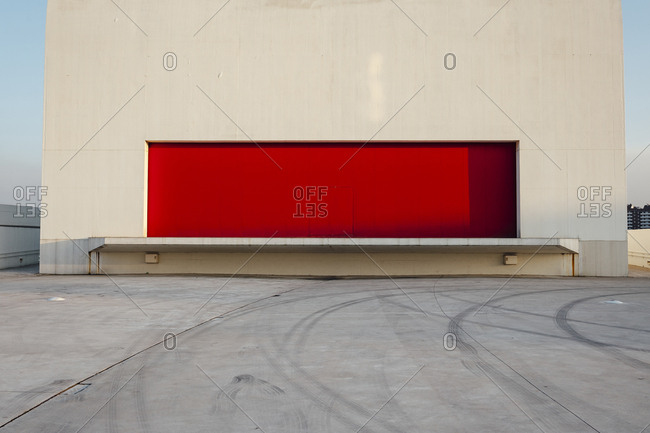 Aviles, Spain -  October 12th, 2017: Red wall on side of white building in Niemeyer Center at sunset