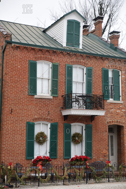 Exterior of brick house with holiday decorations