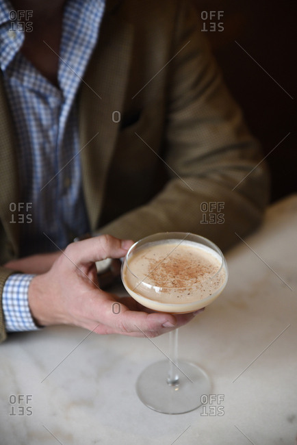 Person holding a cocktail