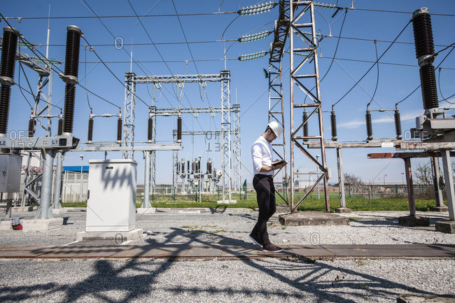 Engineer checking electricity substation