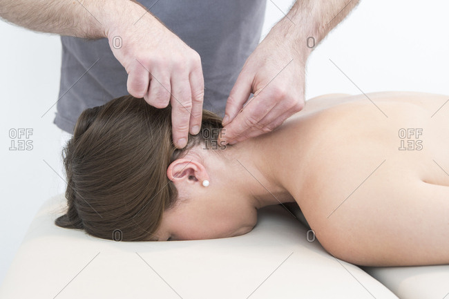 Female patient receiving acupressure, close-up