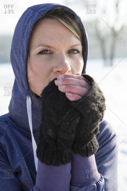 Woman in hooded shirt feeling cold