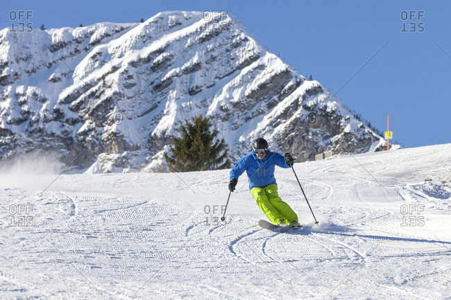 Ski holiday, Skier carving downhill, Sudelfeld, Bavaria, Germany