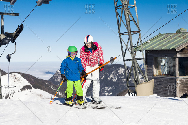 Ski holiday, Mother and son at ski lift, Sudelfeld, Bavaria, Germany