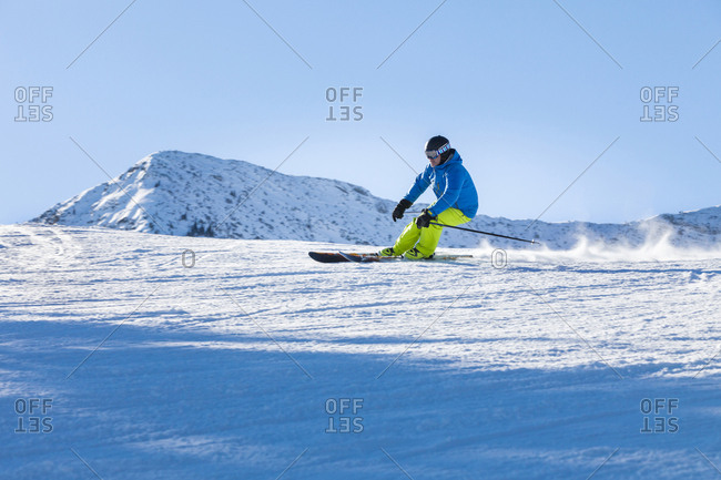 Ski holiday, Skier carving in powder snow, Sudelfeld, Bavaria, Germany