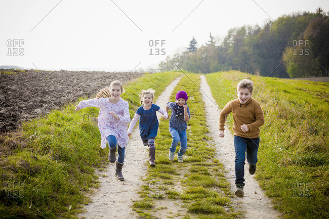 Children running on path