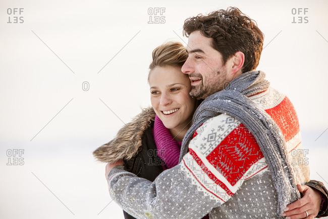 Couple embracing, close-up
