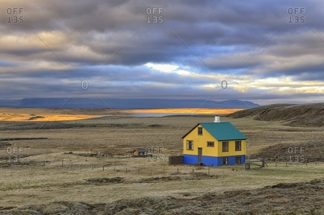 colorful isolated house, lichen-covered lava desert, South West, Iceland, Europe