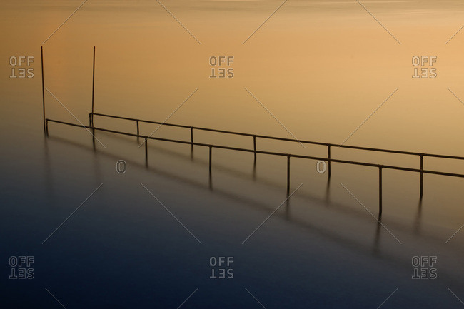 Bathing jetty at Lake Constance in the light of the sunset, Reichenau island, Baden-Wuerttemberg, Germany, Europe
