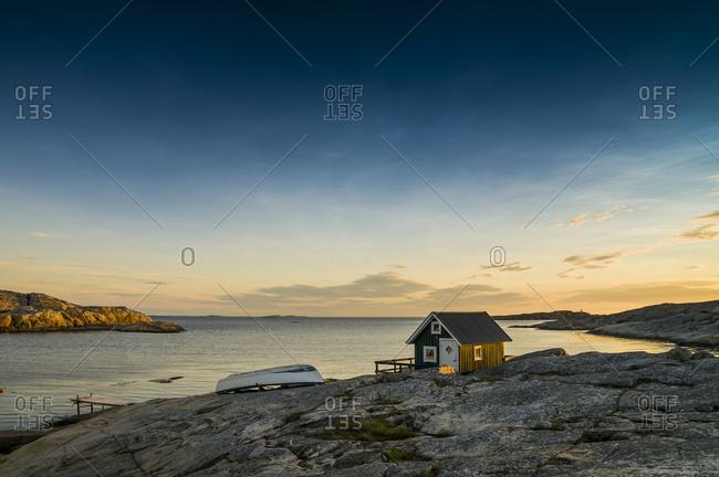 Fisherman's cottage by the sea at sunset, Smogen, Bohuslan, Sweden, Europe