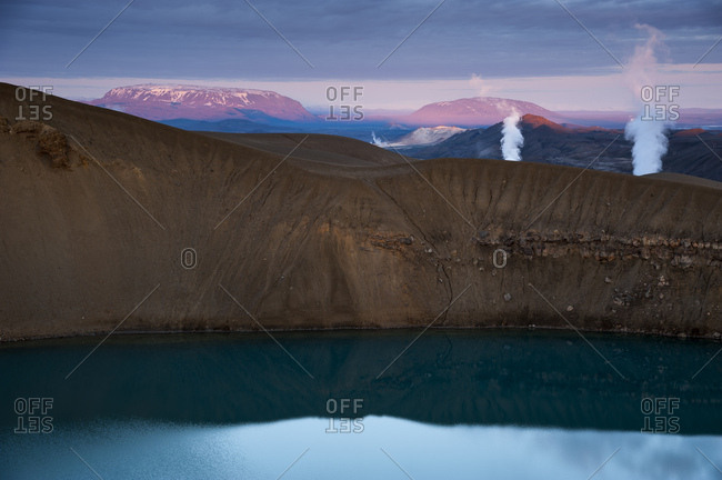 Krafla volcano on Lake Viti, steam from a geothermal power plant, Myvatn area, Norourland eystra, north-east region, Iceland, Europe
