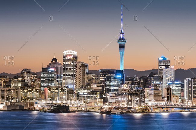March 13, 2013: Skyline of Auckland with the Sky Tower at dusk, Auckland, North Island, New Zealand, Oceania