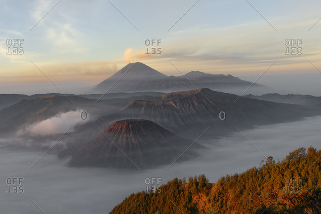 Sunrise over the smoking Gunung Bromo volcano, Bromo-Tengger-Semeru National Park, Java, Indonesia, Asia